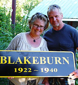 Sharon and James McCulloch holding Blakeburn sign